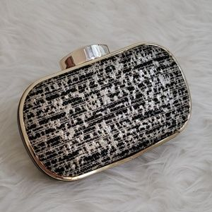 Express black and gold clutch
